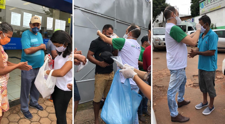 Membros do comitê distribuem máscaras nas ruas.